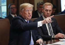 President Donald Trump gestures while speaking during his meeting with members of his cabinet in Cabinet Room of the White House in Washington, Wednesday, July 18, 2018. Looking on is Deputy Secretary of Defense Patrick Shanahan. (AP Photo/Pablo Martinez Monsivais)