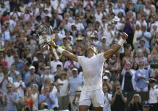 Rafael Nadal of Spain celebrates winning his men's singles match against Czech Republic's Jiri Vesely, on day seven of the Wimbledon Tennis Championships, in London, Monday July 9, 2018. (AP Photo/Tim Ireland)