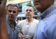 "In this July 25, 2018 photo, Andrew Craig Brunson, an evangelical pastor from Black Mountain, North Carolina, arrives at his house in Izmir, Turkey. An American pastor who had been jailed in Turkey for more than one and a half years on terror and espionage charges was released Wednesday and will be put under house arrest as his trial continues. Vice President Mike Pence said Thursday that if Turkey does not take immediate action to free Brunson, ""the United States of America will impose severe economic sanctions on Turkey,"" in comments at the close of a three-day conference on religious freedom. (AP Photo/Emre Tazegul)"
