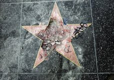 This photo shows Donald Trump's star on the Hollywood Walk of Fame that was vandalized Wednesday, July 25, 2018, in Los Angeles. Los Angeles police Officer Ray Brown said the vandalism was reported early Wednesday and someone was subsequently taken into custody. Authorities said a pickax was used in the vandalism. (AP Photo/Reed Saxon)