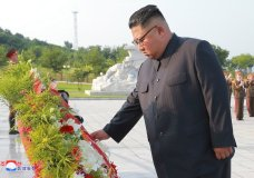 """In this July 26, 2018, photo, provided on July 27, by the North Korean government, North Korean leader Kim Jong Un visits the tombs, on the 65th anniversary of the signing of the ceasefire armistice that ends the fighting in the Korean War, in Pyongyang. Independent journalists were not given access to cover the event depicted in this image distributed by the North Korean government. The content of this image is as provided and cannot be independently verified. Korean language watermark on image as provided by source reads: """"KCNA"""" which is the abbreviation for Korean Central News Agency. (Korean Central News Agency/Korea News Service via AP)"""
