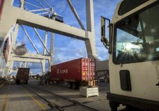 """In this Thursday, July, 5, 2018 photo, Jockey trucks line up to under massive post-Panamax cranes to unload their 40-foot shipping container at the Port of Savannah in Savannah, Ga. The United States and China launched what Beijing called the """"biggest trade war in economic history"""" Friday, July 6, imposing tariffs on billions of dollars of each other's goods amid a spiraling dispute over technology. (AP Photo/Stephen B. Morton)"""