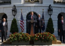 President Donald Trump delivers remarks about the economy on the South Lawn of the White House, Friday, July 27, 2018, in Washington. From left, Commerce Secretary Wilbur Ross, Trump, Vice President Mike Pence, and Treasury Secretary Steve Mnuchin. (AP Photo/Evan Vucci)
