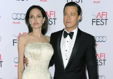 "FILE - In this Nov. 5, 2015 file photo, Angelina Jolie, left, and Brad Pitt arrive at the 2015 AFI Fest opening night premiere of ""By The Sea"" in Los Angeles. Jolie Pitt says she wants her divorce from Brad Pitt finalized before the end of the year, and that she intends to seek retroactive child support. The declarations came in a request for a case-management conference filed Tuesday by Jolie Pitt's attorneys in Los Angeles Superior Court. (Photo by Richard Shotwell/Invision/AP, File)"