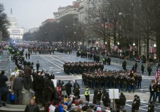 FILE - In this Jan. 20, 2017, file photo, military units participate in the inaugural parade from the Capitol to the White House in Washington, Friday, Jan. 20, 2017. A U.S. official says the 2018 Veterans Day military parade ordered up by President Donald Trump would cost about $92 million _ more than three times the maximum initial estimate. (AP Photo/Cliff Owen, File)
