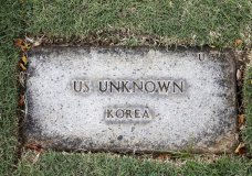 A grave marker for an unknown soldier from the Korean War is shown at the National Memorial Cemetery of the Pacific in Honolulu on Monday, July 30, 2018. Human remains handed over to the U.S. government from North Korea are expected to arrive Wednesday in Honolulu, where scientists will begin the painstaking process of trying to match DNA from the bones to those of American soldiers who didn't return from the Korean War more than a half century ago. (AP Photo/Caleb Jones)