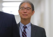 "In this Aug. 28, 2018, file photo, Justice Department official Bruce Ohr arrives for a closed hearing of the House Judiciary and House Oversight committees on Capitol Hill in Washington. A former British spy told Ohr, a senior Justice Department lawyer, at a breakfast meeting on July 30, 2016, that Russian intelligence believed it had Donald Trump ""over a barrel,"" according to multiple people familiar with the encounter. (AP Photo/Pablo Martinez Monsivais)"