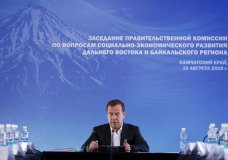 """Russian Prime Minister Dmitry Medvedev speaks during a meeting in Kamchatka Peninsula region, Russian Far East, Russia, Friday, Aug. 10, 2018. Russia's prime minister sternly warned the United States on Friday against ramping up sanctions, saying that Moscow will retaliate with economic, political and unspecified """"other"""" means. (Dmitry Astakhov, Sputnik, Government Pool Photo via AP)"""