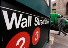 FILE- In this April 5, 2018, file photo, a sign for a Wall Street subway station is shown in New York. Stocks are opening lower on Wall Street, Thursday, Aug. 2, led by declines in technology and industrial companies as the U.S. ratcheted up trade tensions with China. (AP Photo/Richard Drew, File)