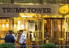 "In this July 27, 2018 photo, police investigate the report of a ""suspicious item"" inside Trump Tower on Fifth Avenue, in New York. AP explains why the Trump Tower meeting matters in the Mueller probe. (AP Photo/Craig Ruttle)"