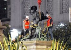 This photo from video provided by KTVU-TV shows crews removing a statue that some have called racist and demeaning to indigenous people, near City Hall in San Francisco early in the morning of Friday, Sept. 14, 2018. The statue depicts a Native American at the feet of a Spanish cowboy and a Catholic missionary, part of a group of statues depicting the founding of California. A San Francisco board voted unanimously on Wednesday to remove it. (KTVU-TV via AP)