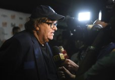"Michael Moore speaks with journalists as he attends the premiere for ""Fahrenheit 11/9"" on day 1 of the Toronto International Film Festival at the Ryerson Theatre on Thursday, Sept. 6, 2018, in Toronto. (Photo by Arthur Mola/Invision/AP)"