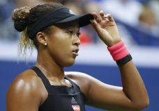Naomi Osaka, of Japan, adjusts her hat during a match against Serena Williams in the women's final of the U.S. Open tennis tournament, Saturday, Sept. 8, 2018, in New York. (AP Photo/Adam Hunger)