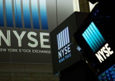 FILE- In this May 10, 2018, file photo signs for the New York Stock Exchange hang above the trading floor. The U.S. stock market opens at 9:30 a.m. EDT on Wednesday, Sept. 26. (AP Photo/Mark Lennihan, File)