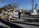 Clinton Moseley walks past debris in the aftermath of Hurricane Michael in Panama City, Fla., Saturday, Oct. 13, 2018. (AP Photo/Gerald Herbert)