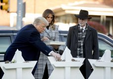 From left, President Donald Trump, accompanied by first lady Melania Trump, and Tree of Life Rabbi Jeffrey Myers, puts down a stone from the White House at a memorial for those killed at the Tree of Life Synagogue in Pittsburgh, Tuesday, Oct. 30, 2018. (AP Photo/Andrew Harnik)