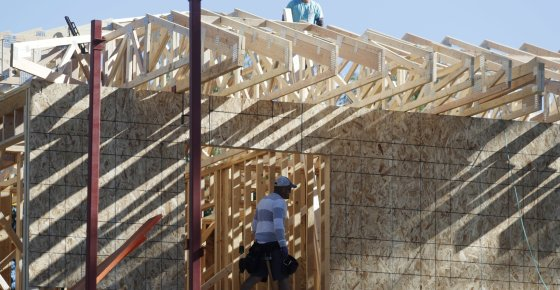 FILE- In this Aug. 30, 2018, file photo a workers toil on a new home under construction in Denver. On Wednesday, Oct. 17, the Commerce Department reports on U.S. home construction in September. (AP Photo/David Zalubowski, File)