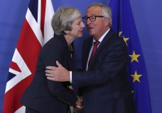 British Prime Minister Theresa May, left, hugs Jean-Claude Juncker, President of the European Commission, as they meet in Brussels, Wednesday, Oct. 17, 2018 when European leaders meet to negotiate on terms of Britain's divorce from the European Union. (AP Photo/Francisco Seco)