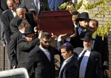 Pallbearers carry the casket of Joyce Fienberg from the Beth Shalom Synagogue following a funeral service in the Squirrel Hill neighborhood of Pittsburgh, Wednesday, Oct. 31, 2018. Fienberg, 75, Melvin Wax, 87 and Irving Younger, 69 were to be laid to rest as part of a weeklong series of services for the 11 people killed in a shooting rampage at the Tree of Life synagogue Saturday. (AP Photo/Gene J. Puskar)