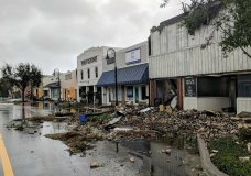 Hurricane Michael formed off the coast of Cuba carrying major Category 4 landfall in the Florida Panhandle. Surge in the Big Bend area, along with catastrophic winds at 155mph. Port St. Joe Lodge number 111, at right, lay in ruins on Reid Avenue on Wednesday, Oct. 10, 2018, in Port St. Joe, Fla., after Hurricane Michael made landfall in the Florida Panhandle. (Douglas R. Clifford/The Tampa Bay Times via AP)