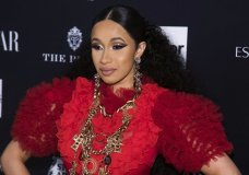 """FILE - In this Sept. 7, 2018, file photo, Cardi B attends the Harper's BAZAAR """"ICONS by Carine Roitfeld"""" party at The Plaza in New York. Cardi B is at a New York City police station on Monday, Oct. 1, 2018, as part of an investigation of her possible involvement in a fight at a strip club. (Photo by Charles Sykes/Invision/AP, File)"""