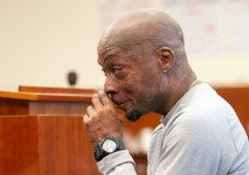 FILE - In this Aug. 10, 2018 file photo, Dewayne Johnson reacts after hearing the verdict in his case against Monsanto at the Superior Court of California in San Francisco. Jurors who found that agribusiness giant Monsanto's Roundup weed killer contributed to the school groundskeeper's cancer are urging a San Francisco judge not to throw out the bulk of their $289 million award in his favor, a newspaper reported Monday, Oct. 15. (Josh Edelson/Pool Photo via AP, File)