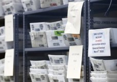 Bins filled with ballots are stacked at the Broward County Supervisor of Elections office as employees count ballots during a recount, Wednesday, Nov. 14, 2018, in Lauderhill, Fla. (AP Photo/Wilfredo Lee)