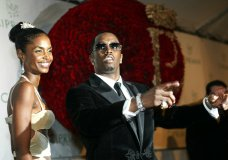 """File-This Nov. 4, 2004, file photo shows Sean """"P. Diddy"""" Combs directing photographers as they sing """"Happy Birthday,"""" to him as his date Kim Porter, left, listens, after Combs arrived for his 35th birthday celebration at Cipriani on Wall Street in New York. Porter, Diddy's former longtime girlfriend and the mother of three of his children, has died. A representative for Combs confirmed the death of the 47-year-old on Thursday, Nov. 15, 2018. No further details were immediately available. (AP Photo/Kathy Willens, File)"""