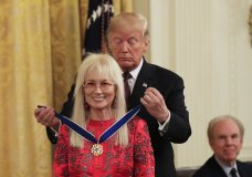 President Donald Trump presents the Presidential Medal of Freedom to Miriam Adelson during a ceremony in the East Room of the White House, in Washington, Friday, Nov. 16, 2018. (AP Photo/Manuel Balce Ceneta)
