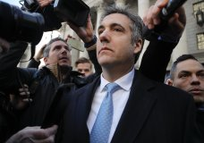 """Michael Cohen walks out of federal court, Thursday, Nov. 29, 2018, in New York. Cohen, President Donald Trump's former lawyer, pleaded guilty to lying to Congress about work he did on an aborted project to build a Trump Tower in Russia. He told the judge he lied about the timing of the negotiations and other details to be consistent with Trump's """"political message."""" (AP Photo/Julie Jacobson)"""