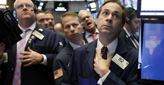 Dudley Devine, right, works with fellow traders on the floor of the New York Stock Exchange, Wednesday, Nov. 14, 2018. Energy companies led U.S. stocks broadly higher in early trading Wednesday, wiping out some of the market's losses from a day earlier. (AP Photo/Richard Drew)