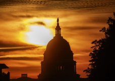 FILE- In this Oct. 26, 2018, file photo the rising sun silhouettes the U.S. Capitol dome at daybreak in Washington. The Treasury Department issues a report Tuesday, Nov. 13, on how much money Uncle Sam took in and paid out last month. (AP Photo/Alex Brandon, File)