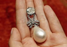 "FILE - In this Friday, Oct. 12, 2018 file photo, the Queen Marie Antoinette Pearl and diamond pendant, from the 18th century, is displayed at Sotheby's, in New York. A large, drop-shaped natural pearl pendant sold for a hammer price of $32 million at an auction of jewelry that once belonged to French queen Marie Antoinette, which Sotheby's is calling a record price for a pearl at auction. The ""Queen Marie Antoinette's Pearl,"" a diamond-and-pearl pendant, was among the highlight offerings on the block at the Sotheby's sale of jewelry from the Bourbon-Parma dynasty on Wednesday, Nov. 14. (AP Photo/Richard Drew, file)"