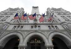 FILE - In this Dec. 21, 2016, file photo, the Trump International Hotel at 1100 Pennsylvania Avenue NW, is seen in Washington. Justice Department's lawyers appeared to be challenging a Maryland federal judge's decision to allow a case against President Donald Trump to move forward. The Nov. 30, 2018, filing, however, was merely a notice to the court. It comes as U.S. District Court Judge Peter J. Messitte is poised to allow the subpoenas to begin flowing on Monday. Such information would likely provide the first clear picture of Trump's Washington, D.C. hotel's finances. (AP Photo/Alex Brandon, File)