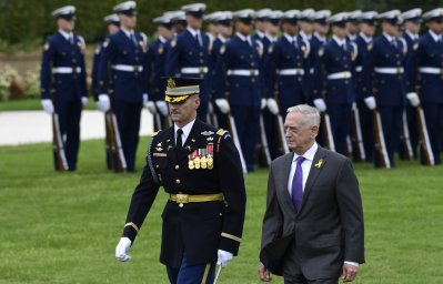 FILE - In this Sept. 21, 2018, file photo, Defense Secretary Jim Mattis reviews the troops during the 2018 POW/MIA National Recognition Day Ceremony at the Pentagon. Outgoing Defense Secretary Jim Mattis is quoting President Abraham Lincoln in a farewell message to defense employees, urging them to stay focused on their mission. (AP Photo/Susan Walsh, File)