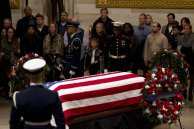 Visitors pay their respects at the flag-draped casket of former President George H.W. Bush, as he lies in state in the Capitol Rotunda in Washington, Wednesday, Dec. 5, 2018. (AP Photo/Jose Luis Magana) AP RADIO Update hourly Ad