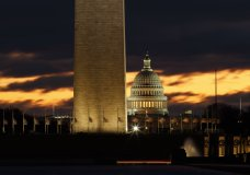 The U.S. Capitol dome is seen past the base of the Washington Monument just before sunrise in Washington, Saturday, Dec. 22, 2018. Hundreds of thousands of federal workers faced a partial government shutdown early Saturday after Democrats refused to meet President Donald Trump's demands for $5 billion to start erecting a border wall with Mexico. (AP Photo/Carolyn Kaster)
