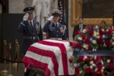 A final salute is rendered by the honor guard standing watch over the flag-draped casket of the late president, George H.W. Bush, as the public viewing comes to an end at the U.S. Capitol Rotunda, Wednesday, Dec. 5, 2018. (AP Photo/J. Scott Applewhite)