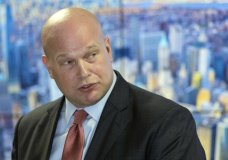 In this Nov. 21, 2018 photo, Acting Attorney General Matthew Whitaker, framed by a photograph of lower Manhattan, addresses law enforcement officials at the Joint Terrorism Task Force in New York. Whitaker has been advised by ethics officials that he does not need to recuse himself from overseeing the special counsel's Russia probe. That's according to a person familiar with the matter who spoke to The Associated Press on Thursday on condition of anonymity. (AP Photo/Mary Altaffer)