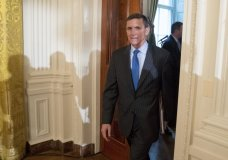 """FILE - In this Jan. 22, 2017 file photo, National Security Adviser Michael Flynn arrives for a White House senior staff swearing in ceremony in the East Room of the White House, in Washington. President Donald Trump's former national security adviser has provided so much information to the special counsel's Russia investigation that prosecutors say he shouldn't do any prison time, according to a court filing Tuesday, Dec. 4, 2018, that describes Flynn's cooperation as """"substantial."""" (AP Photo/Andrew Harnik, File)"""