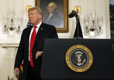 President Donald Trump leaves the podium after speaking about the partial government shutdown, immigration and border security in the Diplomatic Reception Room of the White House, in Washington, Saturday, Jan. 19, 2019. (AP Photo/Alex Brandon)