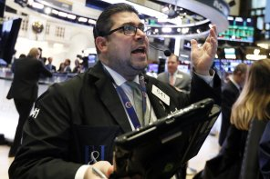 Trader Michael Capolino works on the floor of the New York Stock Exchange, Tuesday, Jan. 8, 2019. Stocks are opening broadly higher on Wall Street, building on two days of solid gains. (AP Photo/Richard Drew)