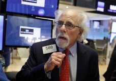 Trader Peter Tuchman works on the floor of the New York Stock Exchange, Thursday, Jan. 3, 2019. Apple's shock warning that its Chinese sales are weakening ratcheted up concerns about the world's second largest economy and weighed heavily on global stock markets as well as the dollar on Thursday. (AP Photo/Richard Drew)
