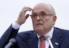 """FILE - In this Aug. 1, 2018 file photo, Rudy Giuliani, an attorney for President Donald Trump, addresses a gathering during a campaign event fin Portsmouth, N.H. Giuliani says he's never said there was no collusion between Russia and members of the Trump campaign. Giuliani's comments Wednesday night on CNN directly contradict the position of his own client, who has repeatedly insisted that there was no collusion during his successful 2016 presidential campaign. Giuliani himself has described the idea of Russian collusion as """"total fake news."""" (AP Photo/Charles Krupa, File )"""