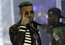 FILE - In this Sept.21, 2018 file photo, singer Chris Brown performs during Philipp Plein's women's 2019 Spring-Summer collection, unveiled during the Fashion Week in Milan, Italy. Two police officials say U.S. singer Chris Brown and two other people are in custody in Paris after a woman filed a rape complaint. (AP Photo/Luca Bruno, File)