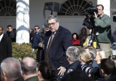 Attorney General William Barr stands at the direction of President Donald Trump during an event in the Rose Garden at the White House to declare a national emergency in order to build a wall along the southern border, Friday, Feb. 15, 2019 in Washington. (AP Photo/Pablo Martinez Monsivais)