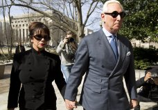 Former campaign adviser for President Donald Trump, Roger Stone accompanied by his wife Nydia Stone, left, arrives at federal court in Washington, Thursday, Feb. 21, 2019. Stone was ordered to appear in court over a Instagram post he made about U.S. Judge Amy Berman Jackson. (AP Photo/Jose Luis Magana)