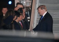 President Donald Trump is greeted after arriving on Air Force One at Noi Bai International Airport, in Hanoi, Vietnam, Tuesday, Feb. 26, 2019. Trump and North Korea's Kim Jong Un are to meet Wednesday in their second summit aimed at addressing perhaps the world's biggest security challenge: Kim's pursuit of a nuclear program that stands on the verge of viably threatening targets around the planet. (AP Photo/Susan Walsh)