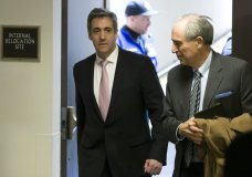 Michael Cohen, left, President Donald Trump's former lawyer, arrives to testify before a closed door hearing of the Senate Intelligence Committee accompanied by his lawyer Lanny Davis of Washington, on Capitol Hill, Tuesday, Feb. 26, 2019, in Washington. (AP Photo/Alex Brandon)