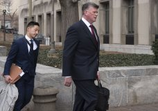 Kevin Downing, Paul Manafort's defense attorney, right, walks to the entrance of federal court on Wednesday, Feb. 13, 2019 in Washington. At left is attorney Tim Wang, another member of the defense team for Manafort. (AP Photo/Kevin Wol